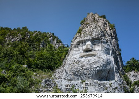 The Danube - The statue of Decebal carved in the mountain - stock photo