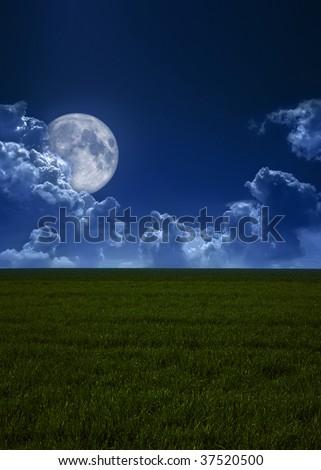 The dark blue sky and the full moon - stock photo