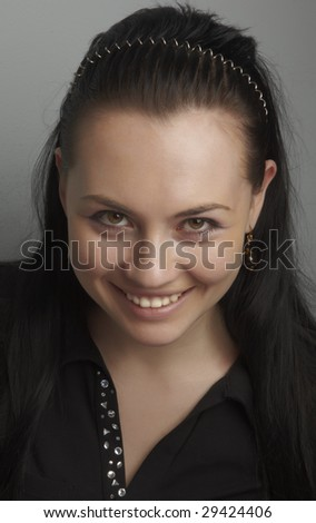 The dark-haired girl in a black blouse with pastes