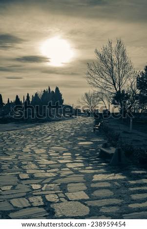 The dark path at Pamukkale - stock photo