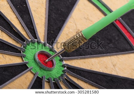 the dart hit the target on dartboard - stock photo