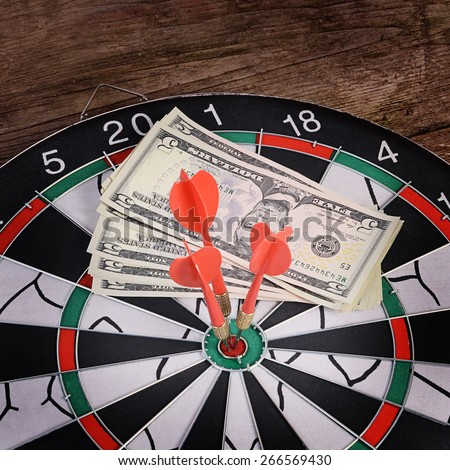 The darts on a wooden background. Macro - stock photo