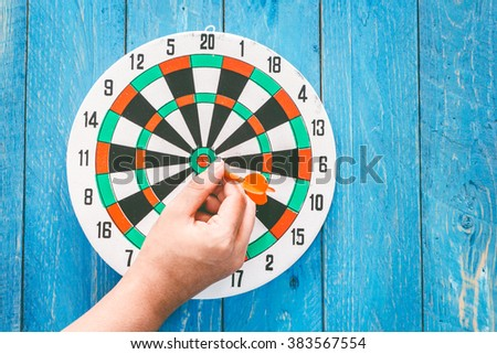 The darts  on wooden background - stock photo