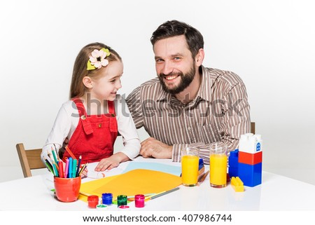 The daughter and father drawing together