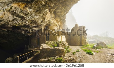 The Davelis cave in Penteli mountain. The cave has been associated with paranormal activity since the ancient times, this being the main reason behind its use as a place of worship. Athens - Greece  - stock photo