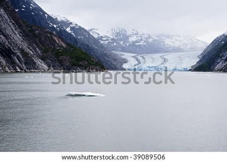The Dawes Glacier in the Endicott Arm of Alaska - stock photo