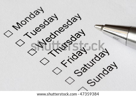 The days of week with checkboxes and pen to mark - stock photo