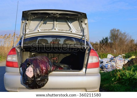 The dead girl in a garbage bag in the trunk - stock photo