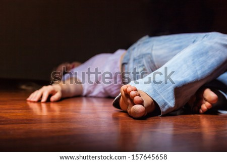 The dead woman's body. Focus on the foot - stock photo