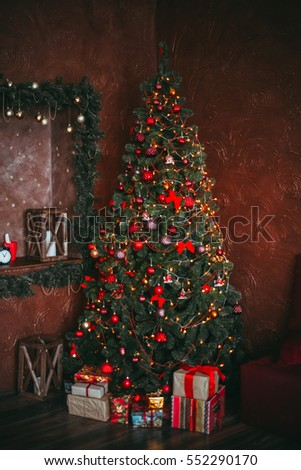 the decorated New Year tree with gifts