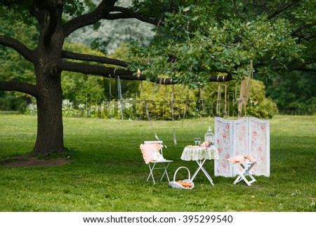 The decoration of the wedding table on nature. Decorating fotozony. The venue for the wedding photo shoot. Wedding picnic for two - stock photo
