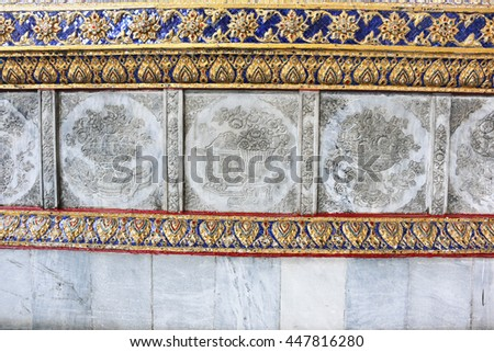 the decoration on the wall in Wat Phra Kaew, Bangkok, Thailand - stock photo