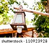The decorative lantern on the pole in the garden. - stock photo