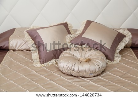 the decorative pillows lying on a bed - stock photo