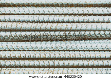 The deform bar, the steel deform bar pile on the construction site in vintage scene. Close-up the corrosion on the steel deform bar which cause of rust in vintage scene. - stock photo