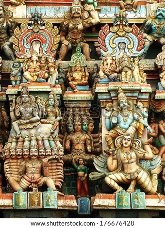 the deities of various Hindu gods carved in a Gopuram in a temple in Kumbakonam ,India - stock photo