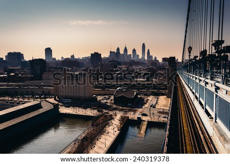 The Delaware River and skyline seen from the Ben Franklin Bridge Walkway, in Philadelphia, Pennsylvania. - stock photo