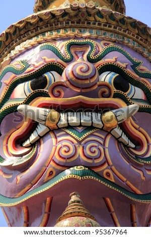 The demon guardian in Temple of the Emerald Buddha, Grand Palace, Bangkok, Thailand.