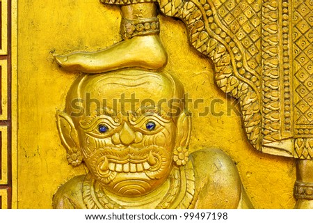 The demon statue under foot - stock photo