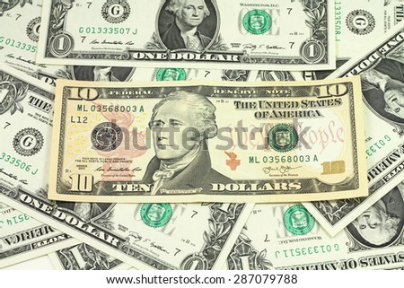 The denomination of ten dollars on a background of dollar bills - stock photo