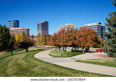 The Denver Tech Center skyline, or DTC, in Autumn with beautiful trees and walking path. - stock photo