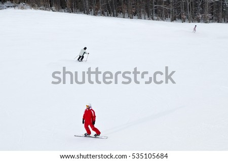 The descent from the ski slopes in the resort of Bukovel - Ukraine. Winter recreation and sport.
