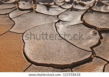 The desert which has cracked from a heat. - stock photo