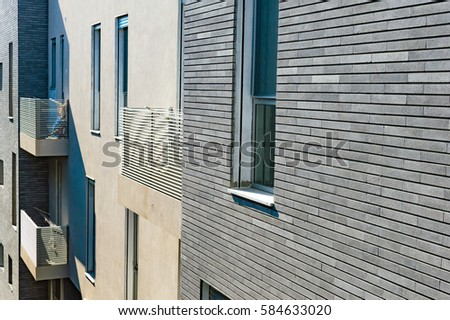 The Design Of Modern Apartment Building With A Facade With Of Tile