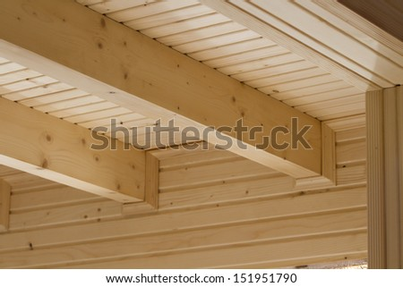 The design of the wooden beams on the ceiling of a new home. - stock photo
