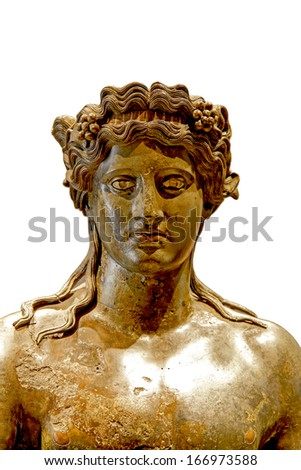 The detail of bronze statue of Dionysus with grape vines in long hair  - stock photo