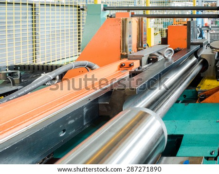 the detail of the hydraulic piston of a bending machine - stock photo