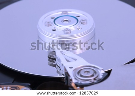 the details of hard disk drive macro, blue tone - stock photo