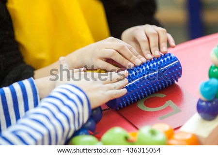The developing toy for children. The developing simmulator for children. The simmulator for children with developmental difficulties. Simmulator for children development. Simmulator toy. - stock photo