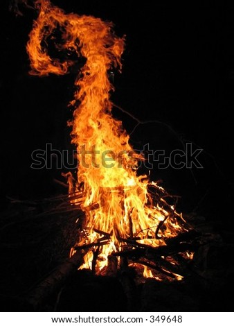 the devil's tail in the fire. - stock photo
