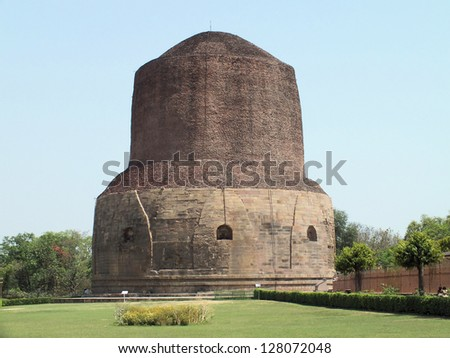 The Dhamek Stupa was built in 500AD to commemorate the Buddha's activities in Sarnath. It is said to mark the spot where the Buddha gave the first sermon to his disciples after attaining enlightenment - stock photo