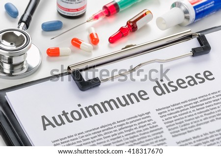 The diagnosis Autoimmune disease written on a clipboard - stock photo