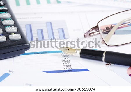 The diagramme with the calculator and pen - stock photo