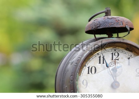 The dial of the old clock close up - stock photo