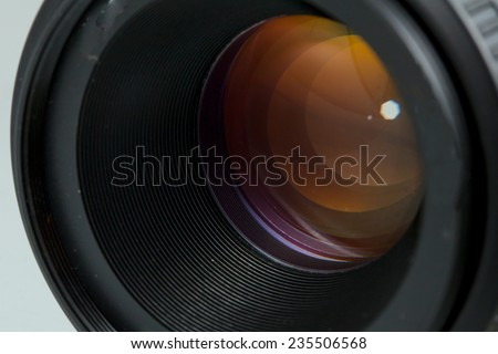 The diaphragm of a camera lens aperture. Selective focus with shallow depth of field. Color toned image