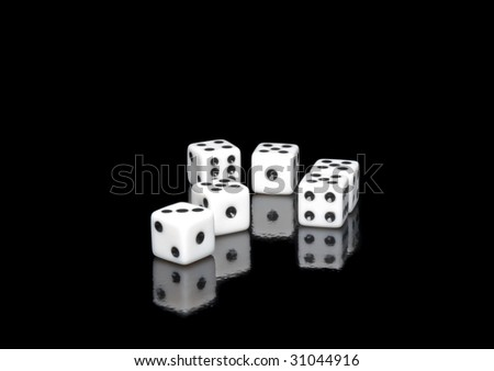 The dice on black background - stock photo