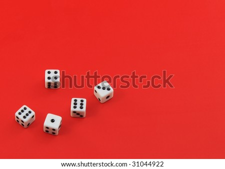 The dice on red background - stock photo