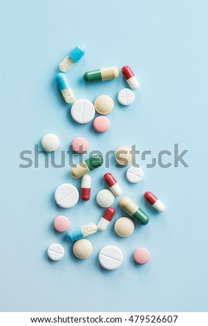 The different pills on blue background.