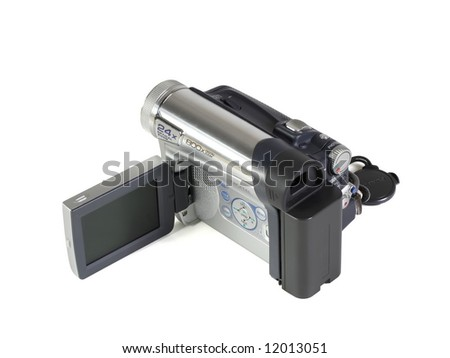The digital videocamera lays on a white background - stock photo