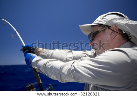 The diligent fisher takes out the big fish - stock photo