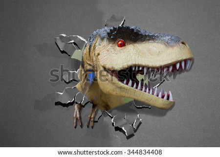 The dinosaur through the paper wall - stock photo