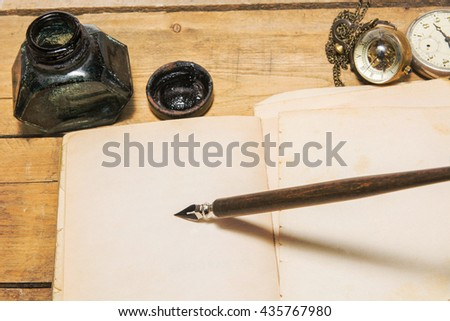 The dip pen on brown paper - stock photo
