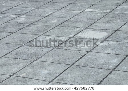 the dirty and old grooved dark concrete road, grid grooved concrete sidewalk/footpath, abstract texture background - stock photo