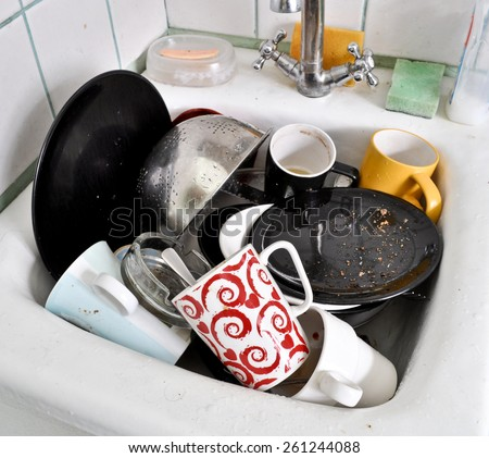 the dirty dishes in the sink - stock photo