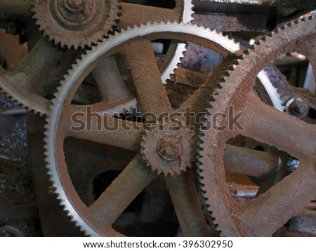 the dirty , dusty and oily machine cogs. in dark tone. (Rusty tone concept) - stock photo