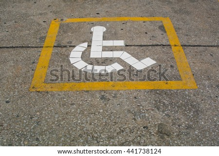 The disability sign on ground. - stock photo